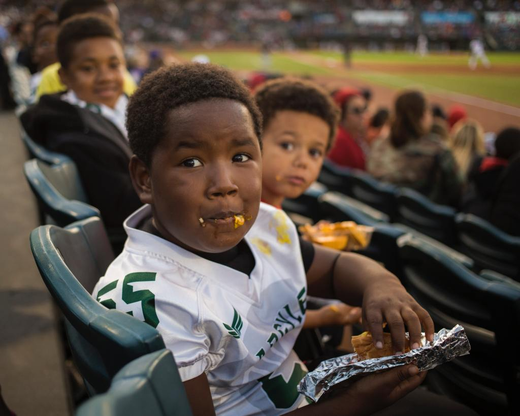 Kids eating at a baseball game